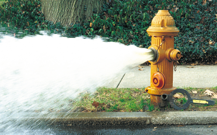 fire hydrant spewing water